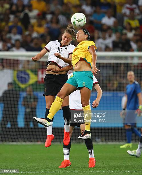 Melanie Leupolz of Germany and Kyah Simon of Australia compete for the ball during the Women's First Round Group F match between Germany and...