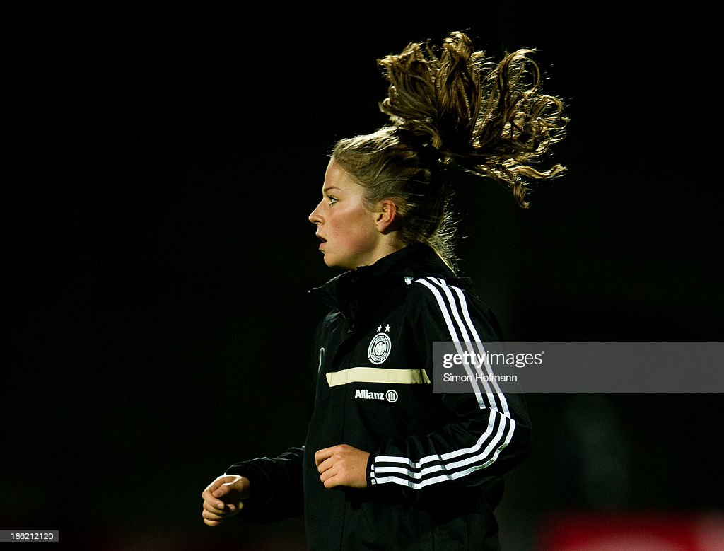 Melanie Leupolz of Germany attends a Germany training session at Volksbank Stadion on October 29, 2013 in Frankfurt am Main, Germany.