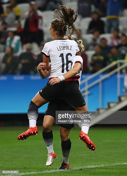 Melanie Leupolz of Germany celebrates after scoring a goal during the Women's First Round Group F match between Zimbabwe and Germany at Arena...