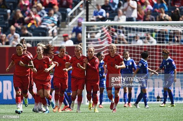 Melanie Leupolz of Germany celebrates with team mates as she scores the opening goal during the FIFA Women's World Cup Canada 2015 Group B match...