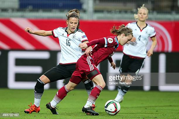 Melanie Leupolz of Germany is challenged by Margarita Chernomyrdina of Russia during the UEFA Women's Euro 2017 Qualifier match between Germany and...