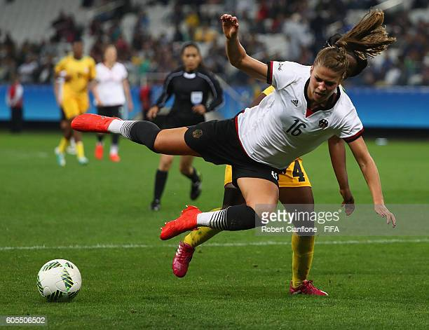Melanie Leupolz of Germany is fouled in the penalty box by Nobuhle Majika of Zimbabwe during the Women's First Round Group F match between Zimbabwe...