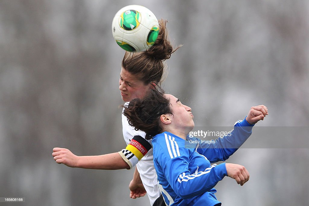Melanie Leupolz (L) of Germany jumps for a header with Triantafyllia Kyriazi of Greece during the Women's UEFA U19 Euro Qualification match between U19 Germany and U19 Greece at Sportzentrum Sued on April 6, 2013 in Kirchheim, Germany.