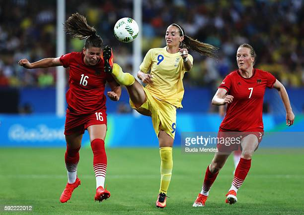 Melanie Leupolz of Germany Kosovare Asllani of Sweden and Melanie Behringer of Germany challenge for the ball during the Women's Olympic Gold Medal...