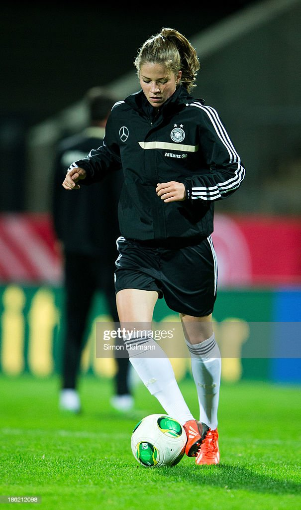 Melanie Leupolz of Germany runs with the ball during a Germany training session at Volksbank Stadion on October 29, 2013 in Frankfurt am Main, Germany.