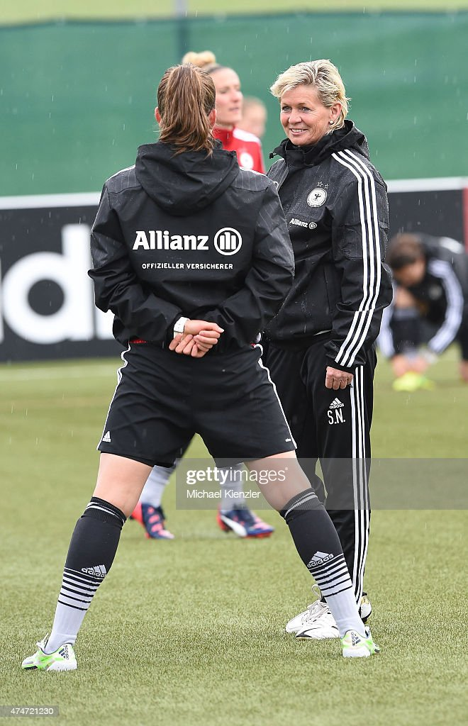 Melanie Leupolz (L) talks to Headcoach Silvia Neid during the German National Women's team training on May 25, 2015 in Wollerau, Switzerland.