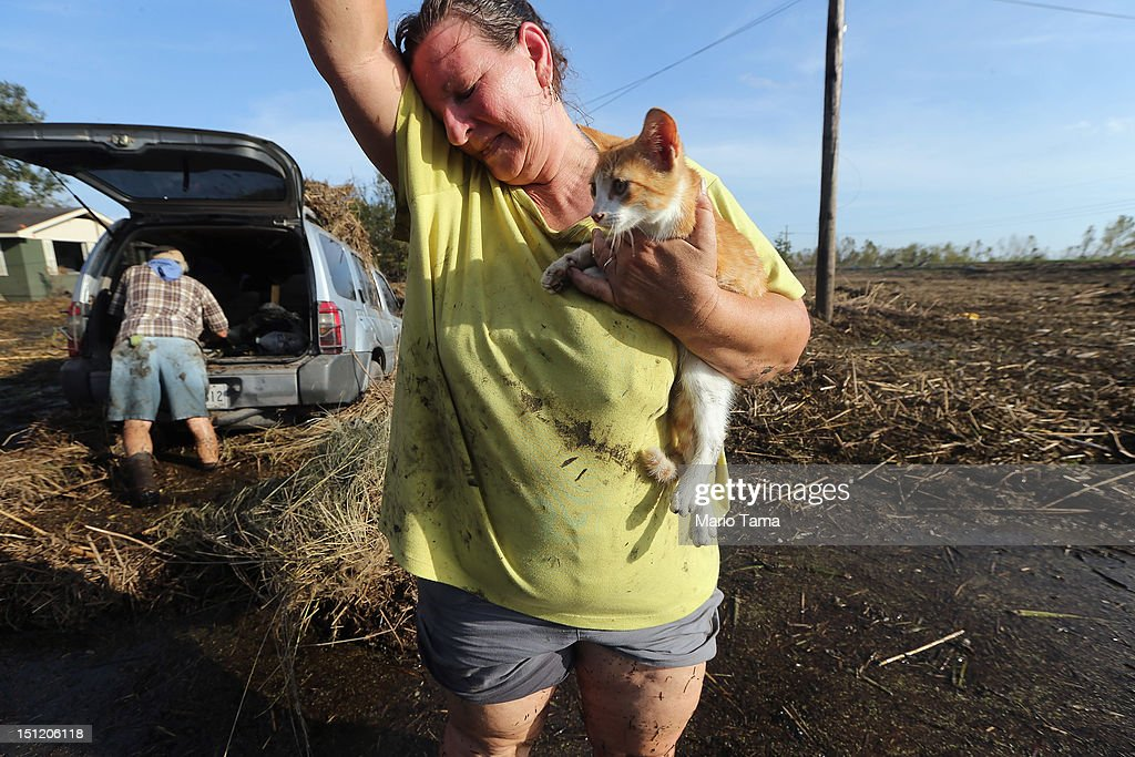Melanie Martinez holds the family cat, which they have renamed Isaac, as they salvage items from their flooded home in Plaquemines Parish on September 3, 2012 in Braithwaite, Louisiana. Martinez, along with her husband Philip and here mother, was forced to ride out the storm in the home when their car broke down. The house quickly flooded and they were rescued by a neighbor who was able to break into their attic to save them. They only were able to find the cat today who survived six days without food at the house. Damage totals from the hurricane could top $2 billion and more than 125,000 customers are still without power six days after the storm made landfall.