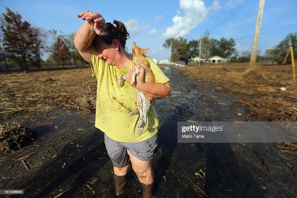 Melanie Martinez holds the family cat, which they have renamed Isaac, after salvaging items from their flooded home in Plaquemines Parish on September 3, 2012 in Braithwaite, Louisiana. Martinez, along with her husband and her mother, was forced to ride out the storm in the home when their car broke down. The house quickly flooded and they were rescued by a neighbor who was able to break into their attic to save them. They only were able to rescue Isaac today who survived six days without food at the flooded home. This is the fifth home Martinez has had destroyed due to hurricanes in Louisiana. Damage totals from the hurricane could top $2 billion more than 125,000 customers are still without power six days after the storm made landfall.