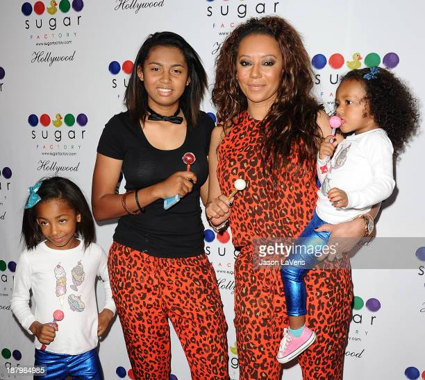 Melanie 'Mel B' Brown and her daughters Angel Iris Murphy Brown Phoenix Chi Gulzar and Madison Brown Belafonte attend the grand opening of Sugar...