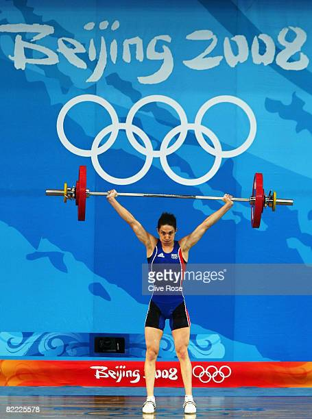 Melanie Noel of France competes in the Women's 48kg Group A Weightlifting event held at the Beijing University of Aeronautics and Astronautics...