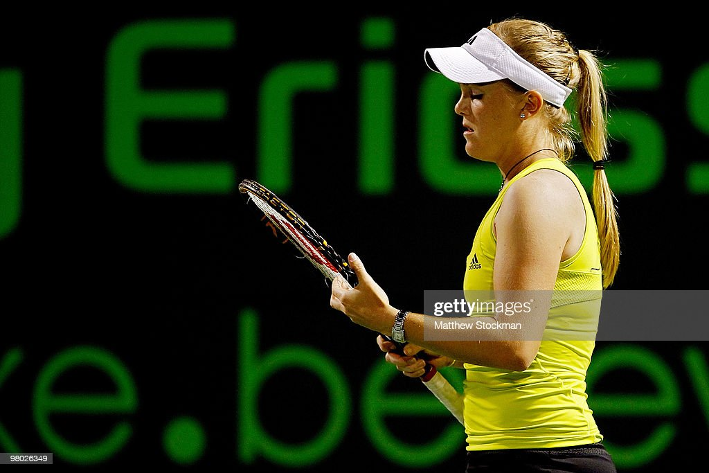 <a gi-track='captionPersonalityLinkClicked' href=/galleries/search?phrase=Melanie+Oudin&family=editorial&specificpeople=5043204 ng-click='$event.stopPropagation()'>Melanie Oudin</a> of the United States adjust her racquet against Michaella Krajicek of the Netherlands during day two of the 2010 Sony Ericsson Open at Crandon Park Tennis Center on March 24, 2010 in Key Biscayne, Florida.