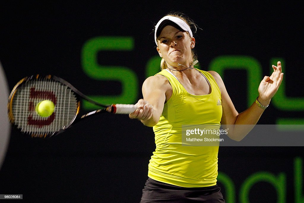 <a gi-track='captionPersonalityLinkClicked' href=/galleries/search?phrase=Melanie+Oudin&family=editorial&specificpeople=5043204 ng-click='$event.stopPropagation()'>Melanie Oudin</a> of the United States returns a shot against Michaella Krajicek of the Netherlands during day two of the 2010 Sony Ericsson Open at Crandon Park Tennis Center on March 24, 2010 in Key Biscayne, Florida.