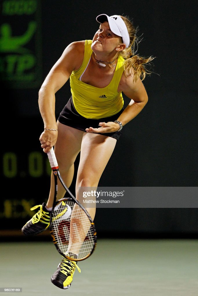 <a gi-track='captionPersonalityLinkClicked' href=/galleries/search?phrase=Melanie+Oudin&family=editorial&specificpeople=5043204 ng-click='$event.stopPropagation()'>Melanie Oudin</a> of the United States serves against Michaella Krajicek of the Netherlands during day two of the 2010 Sony Ericsson Open at Crandon Park Tennis Center on March 24, 2010 in Key Biscayne, Florida.