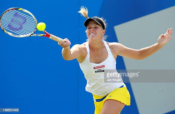 Melanie Oudin of USA hits a return against Jelena Jancovic of Serbia during the singles final match on day eight of the AEGON Classic at Edgbaston...