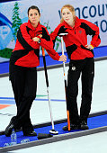 Melanie Robillard and Stella Heiss of Germany react after losing to Denmark during the women's curling round robin game between Denmark and Germany...