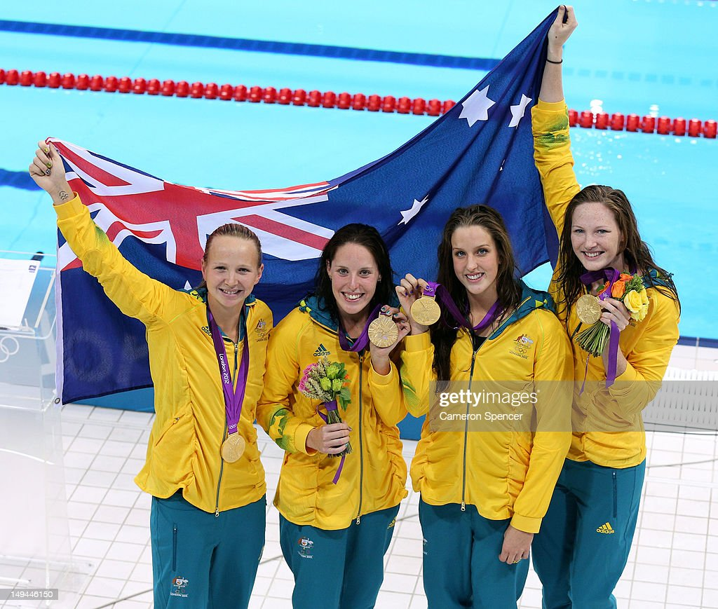 Melanie Schlanger Alicia Coutts Brittany Elmslie and Cate Campbell of Australia celebrate with their gold medalis and their counrty's flag during the...
