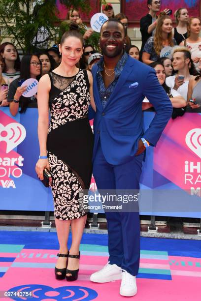 Melanie Scrofano and Shamier Anderson arrives at the 2017 iHeartRADIO MuchMusic Video Awards at MuchMusic HQ on June 18 2017 in Toronto Canada
