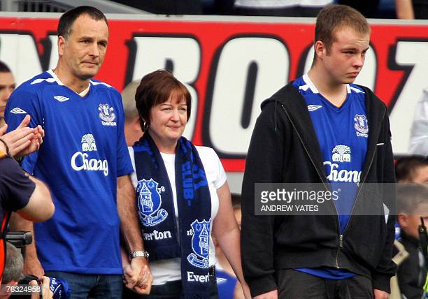 Melanie Stephen Jones parents of murdered school boy Rhys Jones and his brother Owen attend the Premier league football match between Everton and...