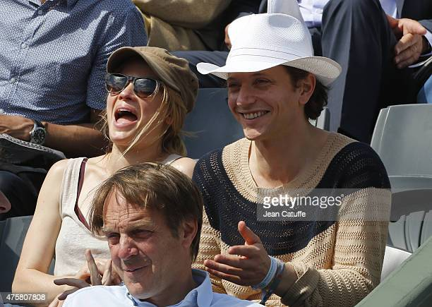 Melanie Thierry and Raphael Haroche attend day 10 of the French Open 2015 at Roland Garros stadium on June 2 2015 in Paris France