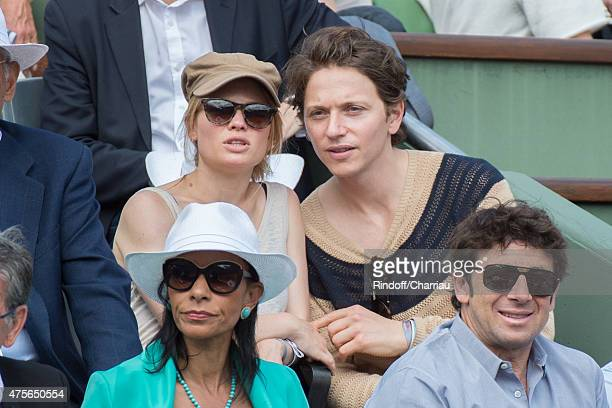 Melanie Thierry and Raphael Haroche attend the French open at Roland Garros on June 2 2015 in Paris France