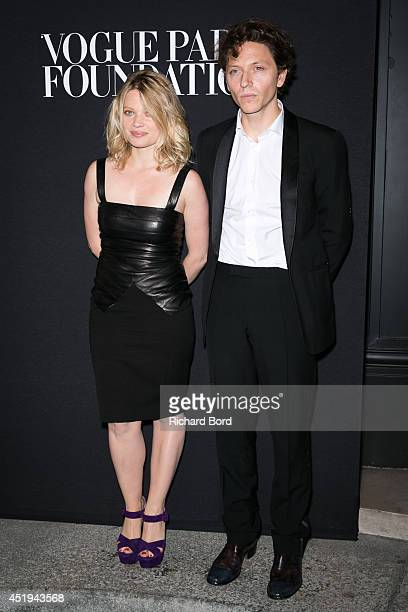 Melanie Thierry and singer Raphael Haroche attends the Vogue Foundation Gala as part of Paris Fashion Week at Palais Galliera on July 9 2014 in Paris...