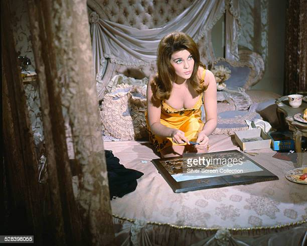 Melba played by SwedishAmerican actress AnnMargret completes a jigsaw puzzle in 'The Cincinnati Kid' directed by Norman Jewison 1965
