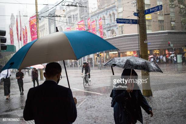 Melbourne Australia 21 march 2017 A view from the street of the central business district as rain is heavily falling Melbourne is ranked as the...