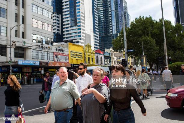 Melbourne Australia 24 march 2017 Pedestrians cross a street of the central business district Melbourne is ranked as the worlds most liveable city...
