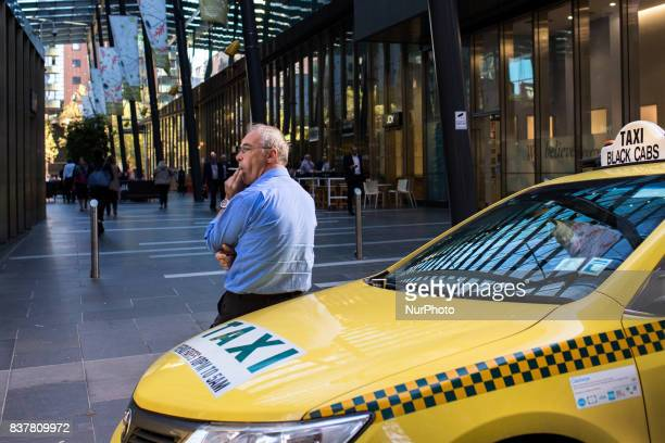 Melbourne Australia 27 march 2017 A taxi men smokes a cigaret in a street of the central business district Melbourne is ranked as the worlds most...