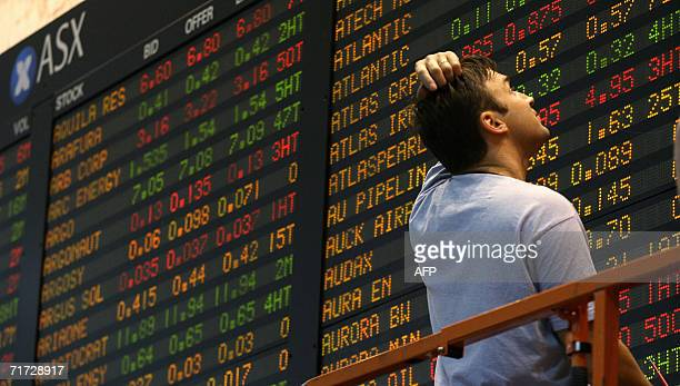A workman is stumped while he erects the Australian Stock Exhange board in Melbourne 28 August 2006 as Australian share prices closed flat as...