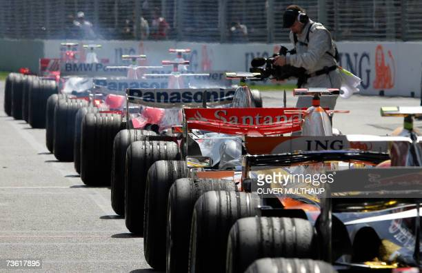 Cars queue in pit lane for the start of the qualifying session of the Australian Formula One Grand Prix in Melbourne 17 March 2007 The first race of...