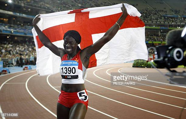 Christine Ohuruogu of England holds the English flag after she won the women's 400 metres title at the Commonwealth Games in Melbourne 21 March 2006...
