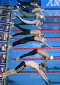 Competitors dive off the blocks in the men's 200m freestyle final 27 March 2007 at the 12th FINA World Swimming Championships Michael Phelps of the...