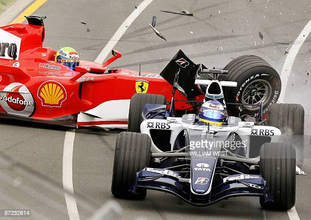 Ferrari driver Felipe Massa of Brazil crashes into the back of Williams driver Nico Rosberg of Germany during the first lap of the Australian Formula...