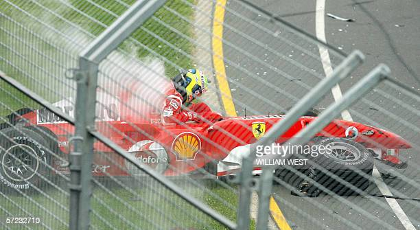 Ferrari driver Felipe Massa of Brazil extracts himself from his race car after crashing into the back of Williams driver Nico Rosberg of Germany...