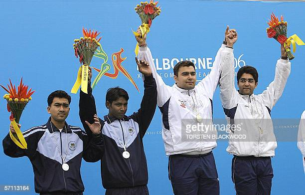 India's Gagan Narang and Abhinav Bindra share the podium with silver medalists Anjan Kumer Singha and Asif Hossain Khan of Bangladesh after winning...