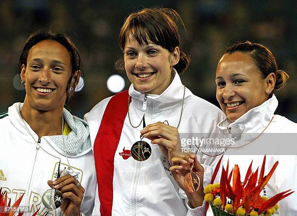 Kelly Sotherton of England shows her gold medal ahead of secondplaced Kyhlie Wheeler of Australia and thirdplaced Jessica Ennis of England during the...