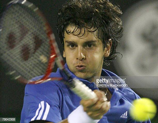 Mario Ancic of Croatia plays a return stroke during his men's singles match against Dominik Hrbaty of Slovakia at the Australian Open tennis...