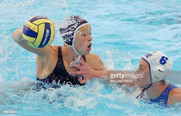 Natalie Golda of the US prepares to get a pass away under pressure from Stavroula Kozompoli of Greece during the preliminary rounds of the women's...