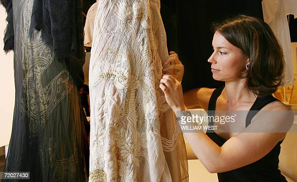 Project Manager Juliet Wilson puts the finishing details to a Akira Isogawa embroided silk organza gradation layered dress which is part of the...