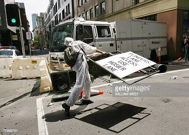 Protesters attack a police truck as masked antiglobalisation protestors hurled bottles and dustbins at police attacked newsmen and tried to scale...