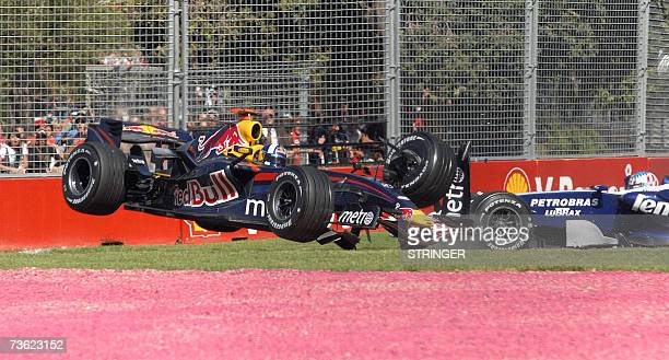 Red Bull's David Coulthard of Great Britain flies through the air after colliding with Alexander Wurz of Austria during the Australian Formula One...