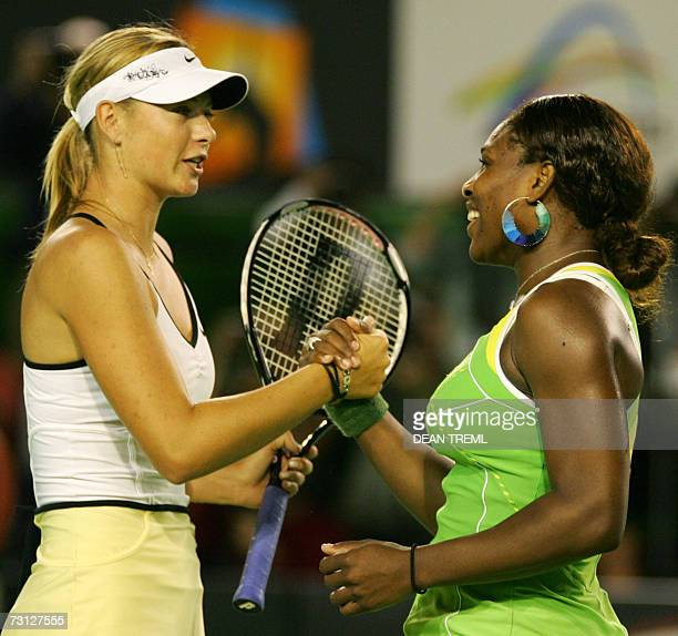 Serena Williams of the US shakes hands with Maria Sharapova of Russia after their women's singles final match at the Australian Open tennis...