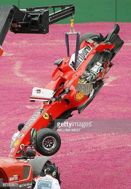 The Ferrari of Felipe Massa of Brazil is removed from the track after crashing into the back of Williams driver Nico Rosberg of Germany during the...