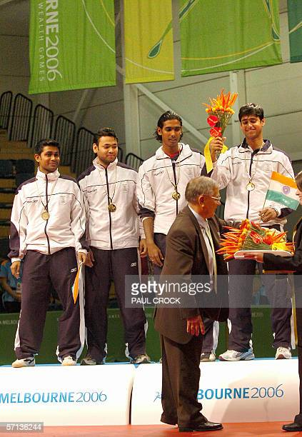 The Indian men's table tennis team receiver their gold medals after winning the team event at the Commonwealth Games in Melbourne 20 March 2006 India...