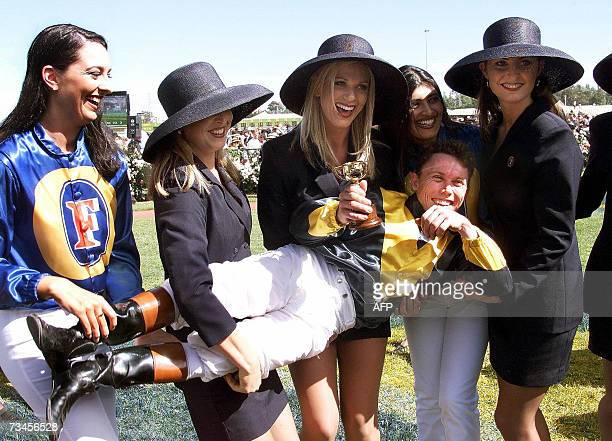 TO GO WITH RacingHKGAUScrimejusticePROFILE This file photo dated 03 November 1998 shows Australian jockey Chris Munce being carried by promotional...