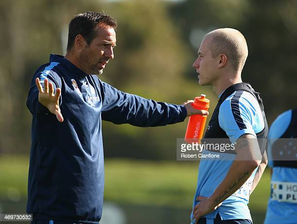 Melbourne City coach John Vant Schip speaks with Aaron Mooy during Melbourne City FC ALeague training session at City Football Academy on April 15...