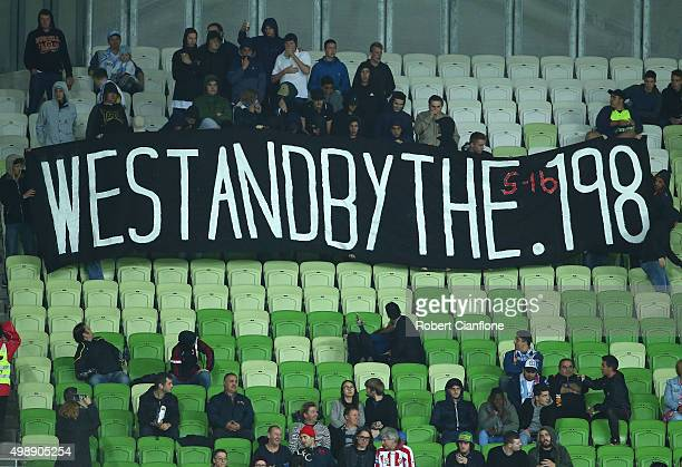 Melbourne City fans hold up signs during the round eight ALeague match between Melbourne City FC and Perth Glory at AAMI Park on November 27 2015 in...