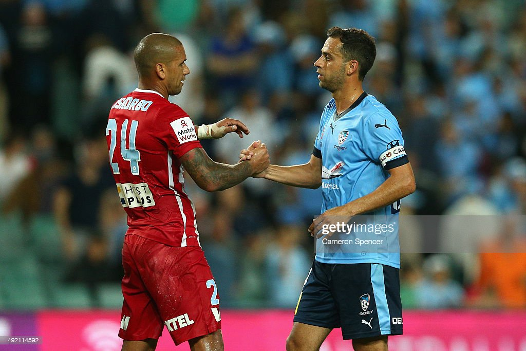 Melbourne City FC captain Patrick Kisnorbo and Sydney FC captain Alex Brosque embrace following the round one A-League match between Sydney FC and Melbourne City FC at Allianz Stadium on October 10, 2015 in Sydney, Australia.