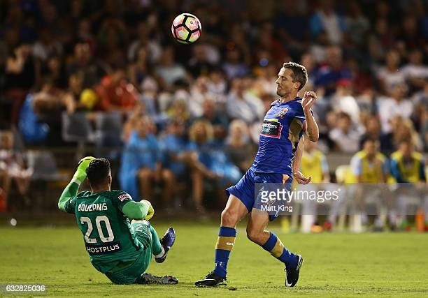 Melbourne City goalkeeper Dean Bouzanis is challenged by Morten Nordstrand of the Jets during the round 17 ALeague match between the Newcastle Jets...